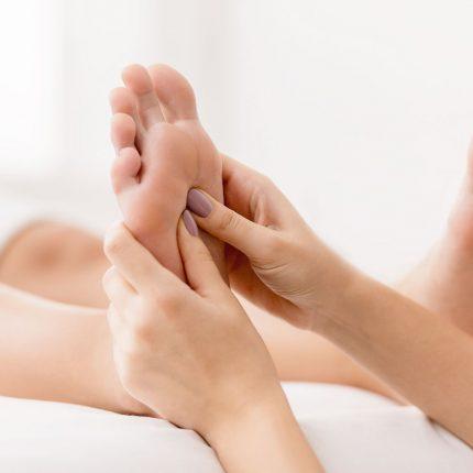 bigstock-reflexology-massager-pressing-290907088